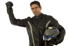 Biker cheer. Biker with the helmet looking sharp Stock Image