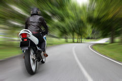 Biker on a country road royalty free stock images