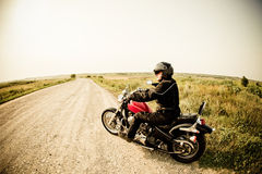 Biker on the country road Stock Photos