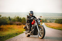 Biker on the country road Stock Images