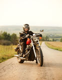 Biker on the country road Stock Image