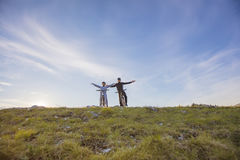 Biker couple with mountain bike pointing in distance at countryside.  Royalty Free Stock Image
