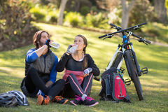 Biker couple relaxing and having water Stock Image