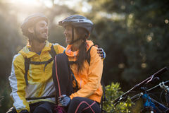 Biker couple sitting and interacting with each other Royalty Free Stock Photo