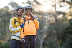 Biker couple standing in countryside forest Stock Photo