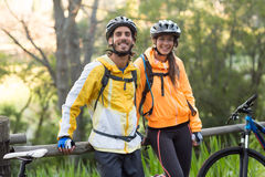 Biker couple standing in countryside forest Royalty Free Stock Photo