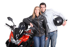 Biker couple. Stod by motorcycle Royalty Free Stock Photos