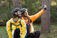 Biker couple taking selfie from mobile phone Royalty Free Stock Images