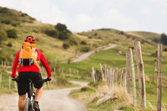 Biker cycling in beautiful mountains Stock Photography