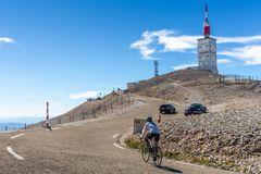 Biker cycling to the hill of Mont Serein Ventoux. Sault, Provence, France - October 3, 2018: Tourist cycling bike on slope hill to the top of Mont Serein Ventoux stock images
