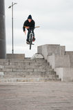 Biker doing bar spin trick Royalty Free Stock Images