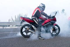 Biker doing burnouts Royalty Free Stock Images