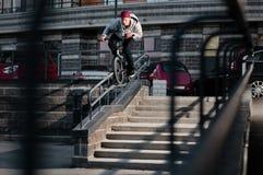 Biker doing double peg grind Royalty Free Stock Image