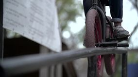 Biker doing peg grind down the hand rail over the stock footage