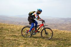 Biker downhill. On autumn hill Royalty Free Stock Images
