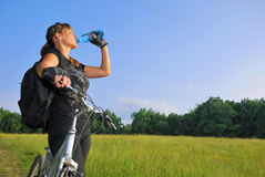 Biker drinking water Stock Photo