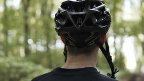 Biker Drinks Water from Bottle stock footage
