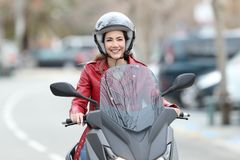 Free Biker Driving A Motorbike On The Street Royalty Free Stock Photos - 113601808