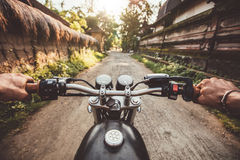Biker driving his motorcycle on country road Royalty Free Stock Image