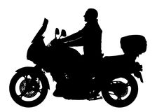 Biker driving a motorcycle rides along the asphalt road  silhouette. Man on bike silhouette. Biker driving a motorcycle rides along the asphalt road  silhouette Royalty Free Stock Image