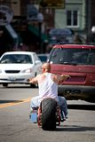 Biker dude. Man without helmet riding his chopper downtown Stock Image