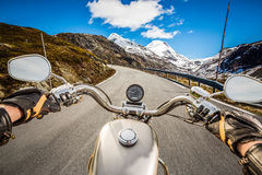 Biker First-person view, mountain serpentine. Stock Photos