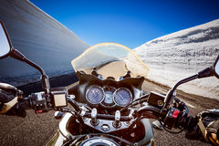 Biker First-person view, mountain serpentine. Royalty Free Stock Images
