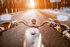 Biker First-person view. Winter slippery road Stock Image