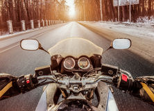 Biker First-person view. Winter slippery road Stock Photography
