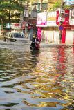 Biker in the flooded city Royalty Free Stock Image