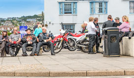 Biker Friends Enjoying Summer. A group of bikers stop and park their motor bikes, for refreshments and some time to  enjoy the summer sun Stock Photography