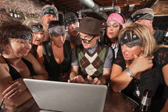 Biker Gang Interested in Nerd on Laptop. Group of impressed biker gang members watching nerd using a computer royalty free stock images
