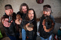 Biker Gang With Weapons. Group of four bikers in leather jackets brandishing weapons Royalty Free Stock Photos
