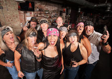 Biker Gang with Weapons and Drinks Royalty Free Stock Images