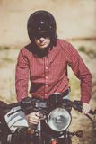 Biker gets his bike, vintage custom motorcycle. Biker with helmet start a vintage custom motorcycle stock photos
