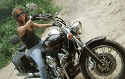 Biker girl Stock Images