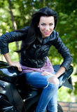Biker girl. Beautiful angry biker girl and power motorcycle stock photography