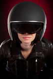 Biker girl in a helmet. On a red background Stock Images