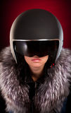 Biker girl in a helmet. On a red background Royalty Free Stock Photos