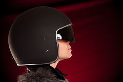 Biker girl in a helmet. On a red background Stock Photo