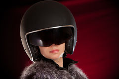 Biker girl in a helmet. On a red background Royalty Free Stock Images