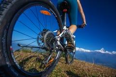 Biker-girl in Himalaya mountains Stock Photo
