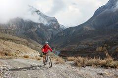 Biker girl in Himalaya mountains, Anapurna region royalty free stock photography