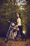 Biker girl in a leather jacket on a motorcycle Royalty Free Stock Images