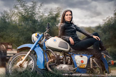Biker Girl in Leather Jacket on Retro Motorcycle stock photos