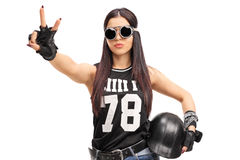 Biker girl making a peace hand sign Stock Image