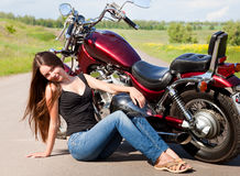 Biker girl on a motorcycle Royalty Free Stock Photography