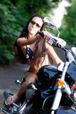 Biker girl on a motorcycle Stock Photo