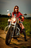 Biker girl and motorcycle Royalty Free Stock Photography