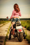 Biker girl and motorcycle Royalty Free Stock Photo